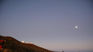 The moon over Science City, a group of observatories at the top of Haleakala